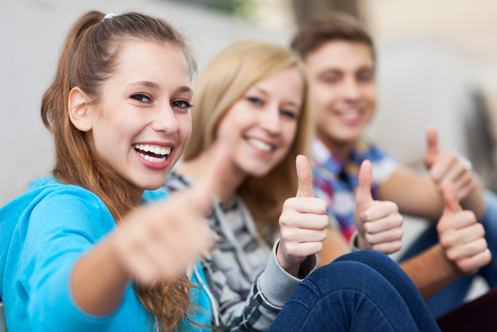 young-students-thumbs-up